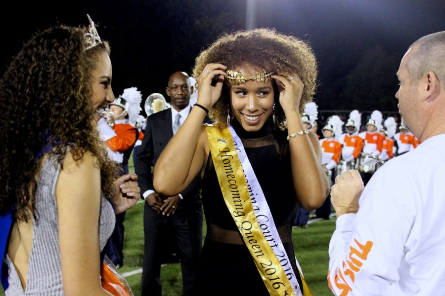 Senior Celina Cotton accepts the crown and sash, symbolizing her win of the class of 2017's Homecoming Queen.