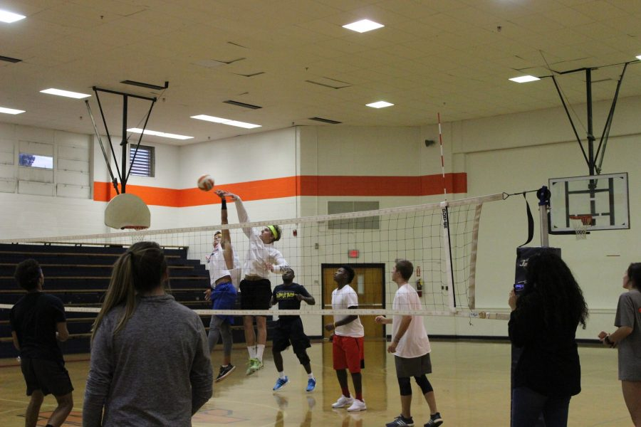 Clay Wright and Andrew Greckel block the other teams hit to solidify a win.