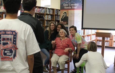 Helen Weingarten, a holocaust survivor, takes photos with NC student after relaying her experience in Auschwitz concentration camp.