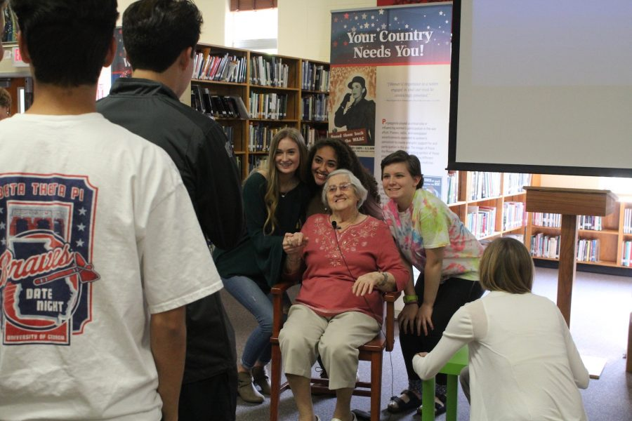 Helen+Weingarten%2C+a+holocaust+survivor%2C+takes+photos+with+NC+student+after+relaying+her+experience+in+Auschwitz+concentration+camp.