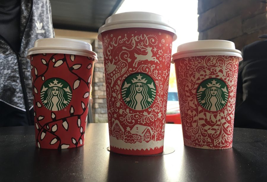 Starbucks released the new holiday cups with designs drawn by 12 customers around the world.
