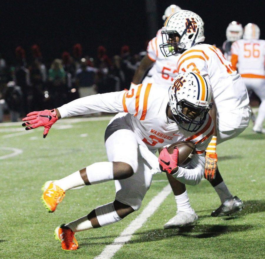 An off-screen Hillgrove defender narrowly trips up senior receiver Quannie Green (3) on a checkdown pass from quarterback Will Lovett in the third quarter.