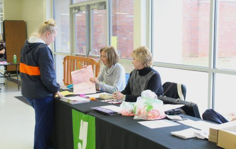 """Senior Peyton Griffin hands in her money for the cap and gown orders, ready for the end of the year. """"Senioritis is officially real. I have confirmed this,"""" Griffin said."""