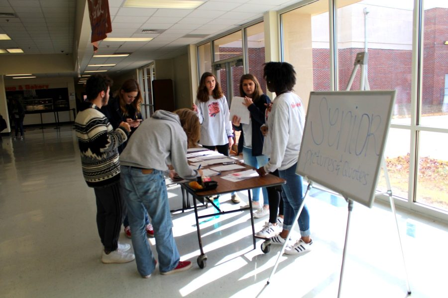 Seniors line up during lunch to finalize their photos and quotes for the yearbook.