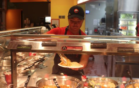 """Katie Yang serves every customer with a smile even though she has a million things on her mind. This makes simple tasks such as plating a plate very difficult. However, Yang composes herself and continues to focus all her attention on the demands of her customers.""""The customer always comes first at Panda,"""" Current Panda Express Employee Katie Yang said"""