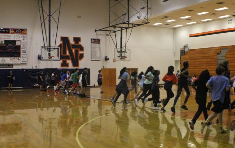 Coach Day's freshman physical education class suffers through a round of the Pacer to examine their running capabilities. Physical education classes run the Pacer once a week to reach a goal of 80 laps by the end of the semester.
