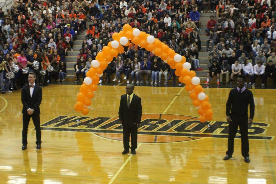 Hoop-coming king Andre Robinson greets crowd at pep rally before being crowned.