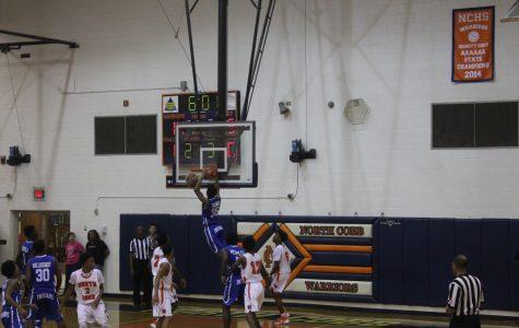 Warrior basketball fall to McEachern on Hoopcoming night