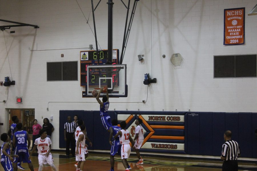 A Mceachern player dunks on the Warriors, summing up the night for both the men's and women's team.