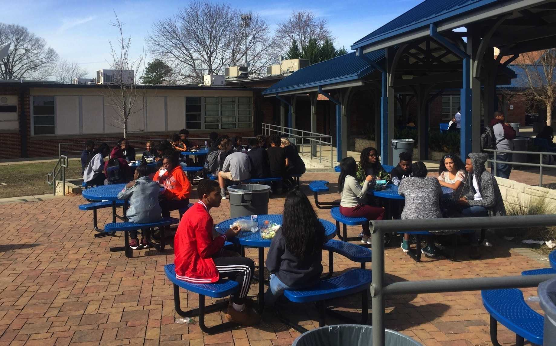 "Students enjoy their lunch outdoors in the 70 degree weather. Georgia's odd weather patterns both fascinate and frustrate the community. ""The weather has been really weird lately, almost like it's going through puberty"" sophomore Lucas Magalhaes jokingly  said."