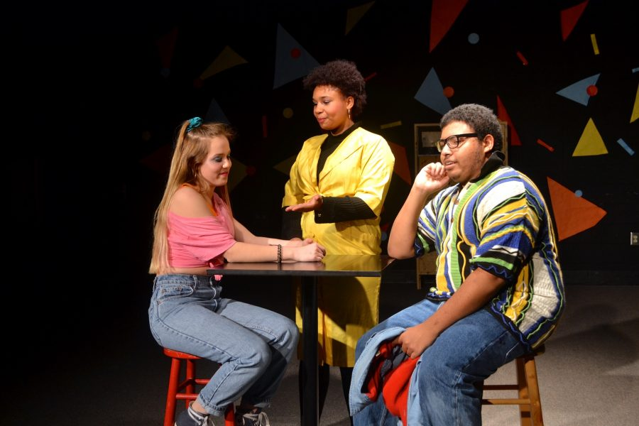 Lola (sophomore Isabella Keaton) and Barry (senior Jordan Warren) dine in an 80s atmosphere with a nefarious waitress (senior Makya Harris).