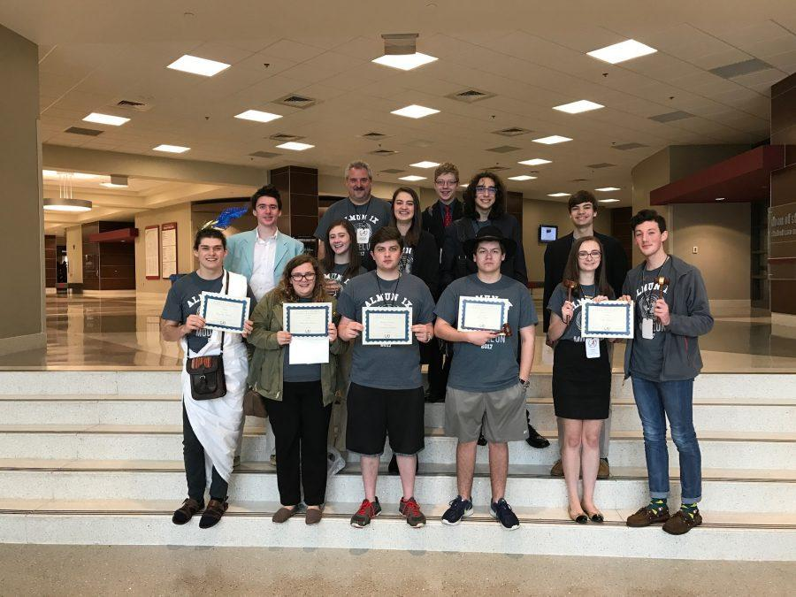 "NC Model UN stands proud at the Ferguson Student Center in the University of Alabama. Holding their awards, NC MUN impressed the chairs for their first time at the conference. ""It was a great experience, and North Cobb brought their A-game,"" Senior Zac Mullinax said."