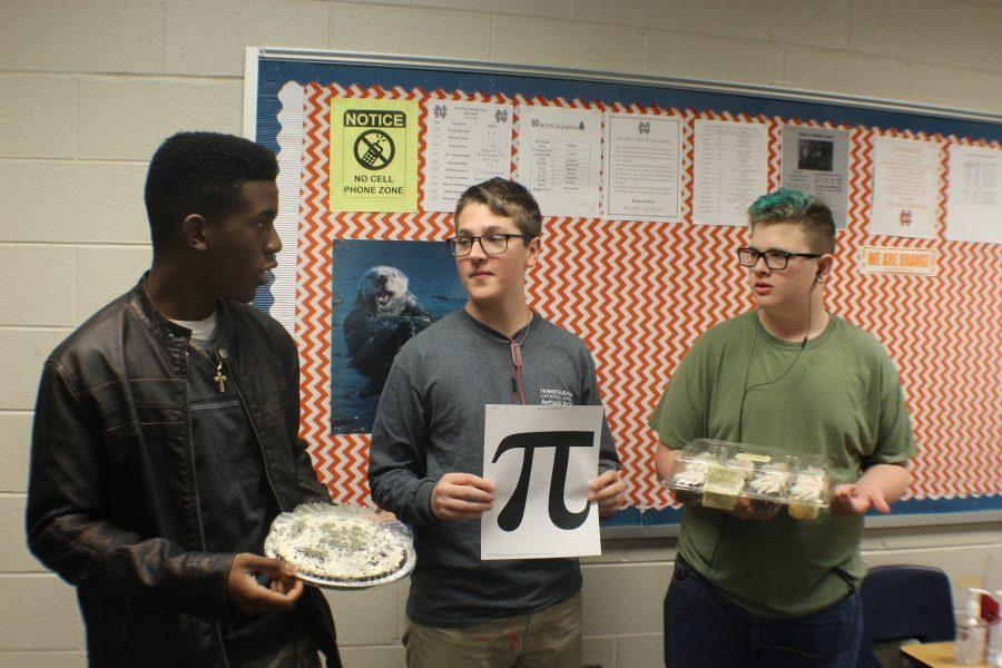 "Sophomores Shaquille Nicolas, Jack Wesselmann, and Robert Underwood celebrate Pi Day in Ms. Armstrong's Geometry class. The class enjoyed desserts including, but not limited to: pie, donuts, cupcakes, and cookies. ""Hopefully, we can learn more about the origin of the number pie and some other number that I don't know already. Obviously, because it's Pi Day, we are going to eat round food that's probably junk food,"" Wesselman said.  Happy Pi Day!"