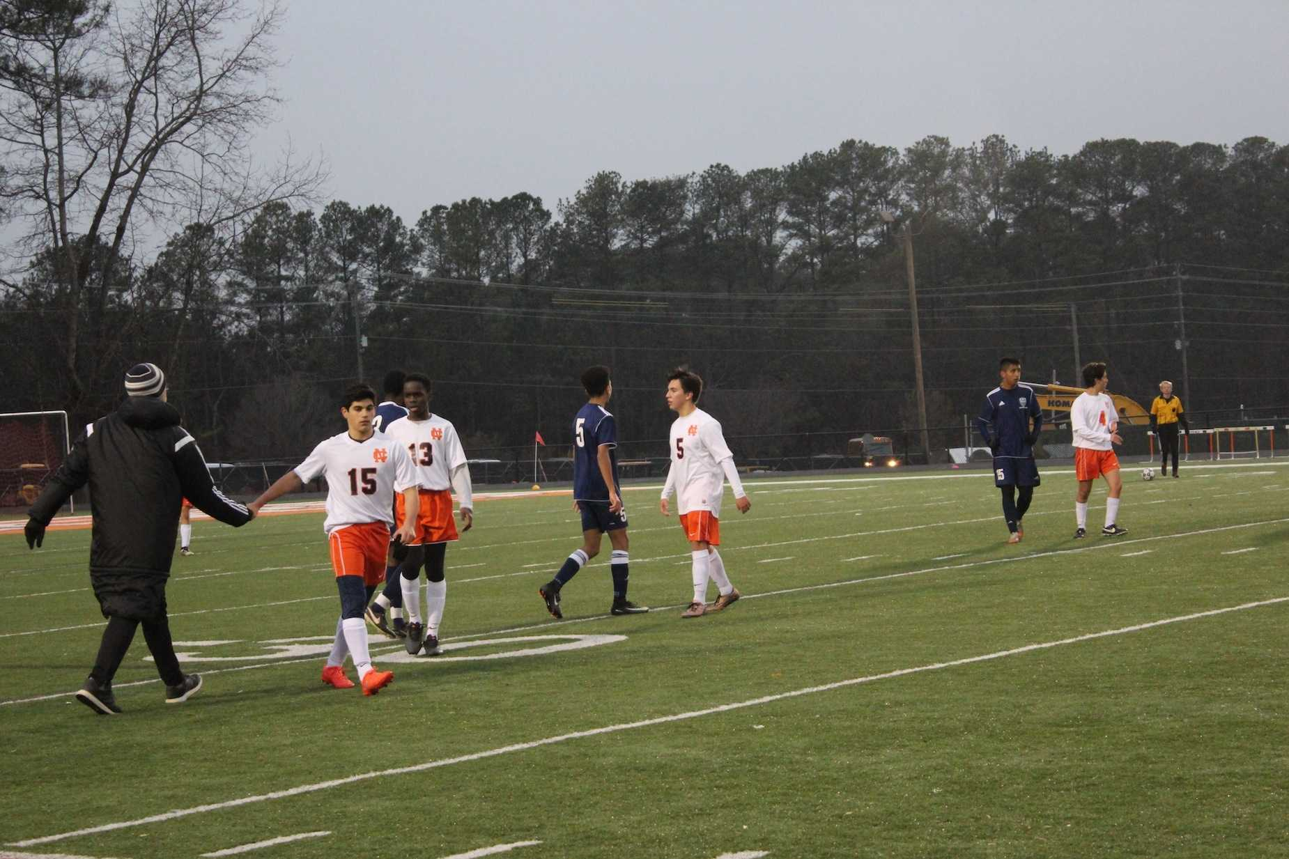 The JV boys celebrated and shook Marietta's hands after a great 4-0 win for the Warriors.