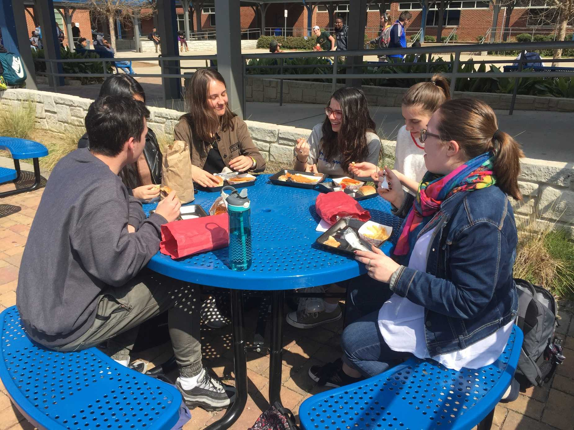 """French exchange students reminisce over their past six days in America during lunch, and converse in their native language. """"We visited the CNN center, everything is expensive in America, so we are ready to go back,"""" said foreign exchange student Marion Morin."""