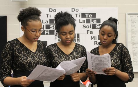 "Chorus students prepare to show off their skills at the annual Large Group Performance Evaluation (LGPE) at Lassiter High School. ""We usually get a superior every year. This may be another year, but we will manage to let the hard work pay off and get first place once again,"" Sophomore Ellaya Johnson said."