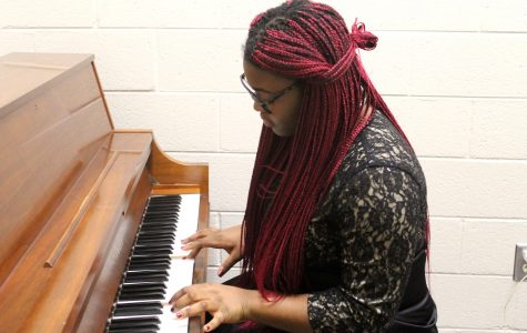 "Sophomore Zaarah Ukechir goes over the starting note for each of her music to help prepare for the stressful day ahead of her. ""As long as we all start on this note, we should all be in tune and make the most of LGPE,"" she said."