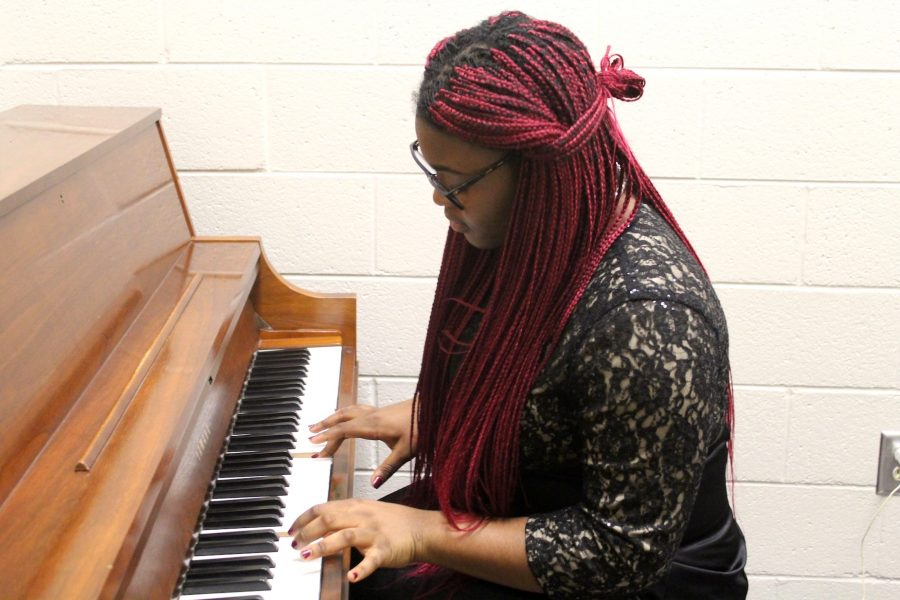 """Sophomore Zaarah Ukechir goes over the starting note for each of her music to help prepare for the stressful day ahead of her. """"As long as we all start on this note, we should all be in tune and make the most of LGPE,"""" she said."""