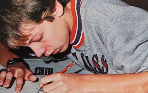 A 1988 NC student diligently concentrates on his classwork while on his right hand he sports his personalized class ring.