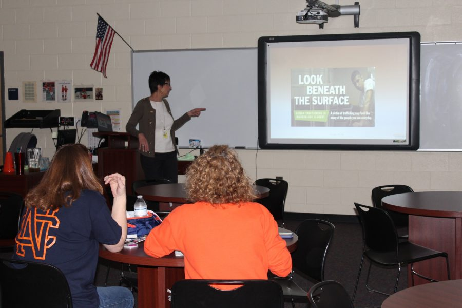 Forensic nurse Gina Seger spreads awareness to students and staff by going through a brief powerpoint about the austerity of human trafficking.