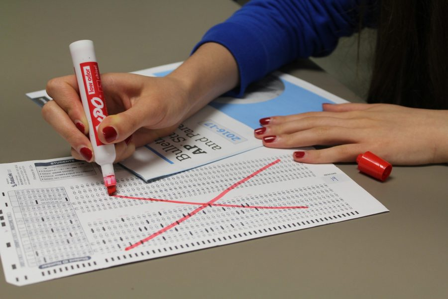 A teacher officially destroys her final Scantron. NC will no longer use any standardized testing in the classroom.