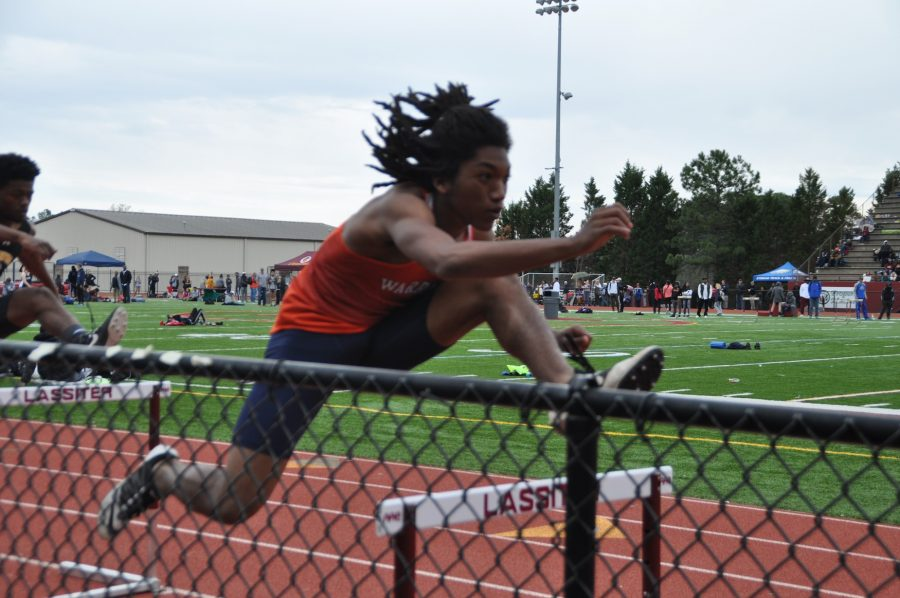 Senior+Trenton+Johnson+looks+onward+with+determination+as+he+leaps+over+his+final+hurdle.%0A