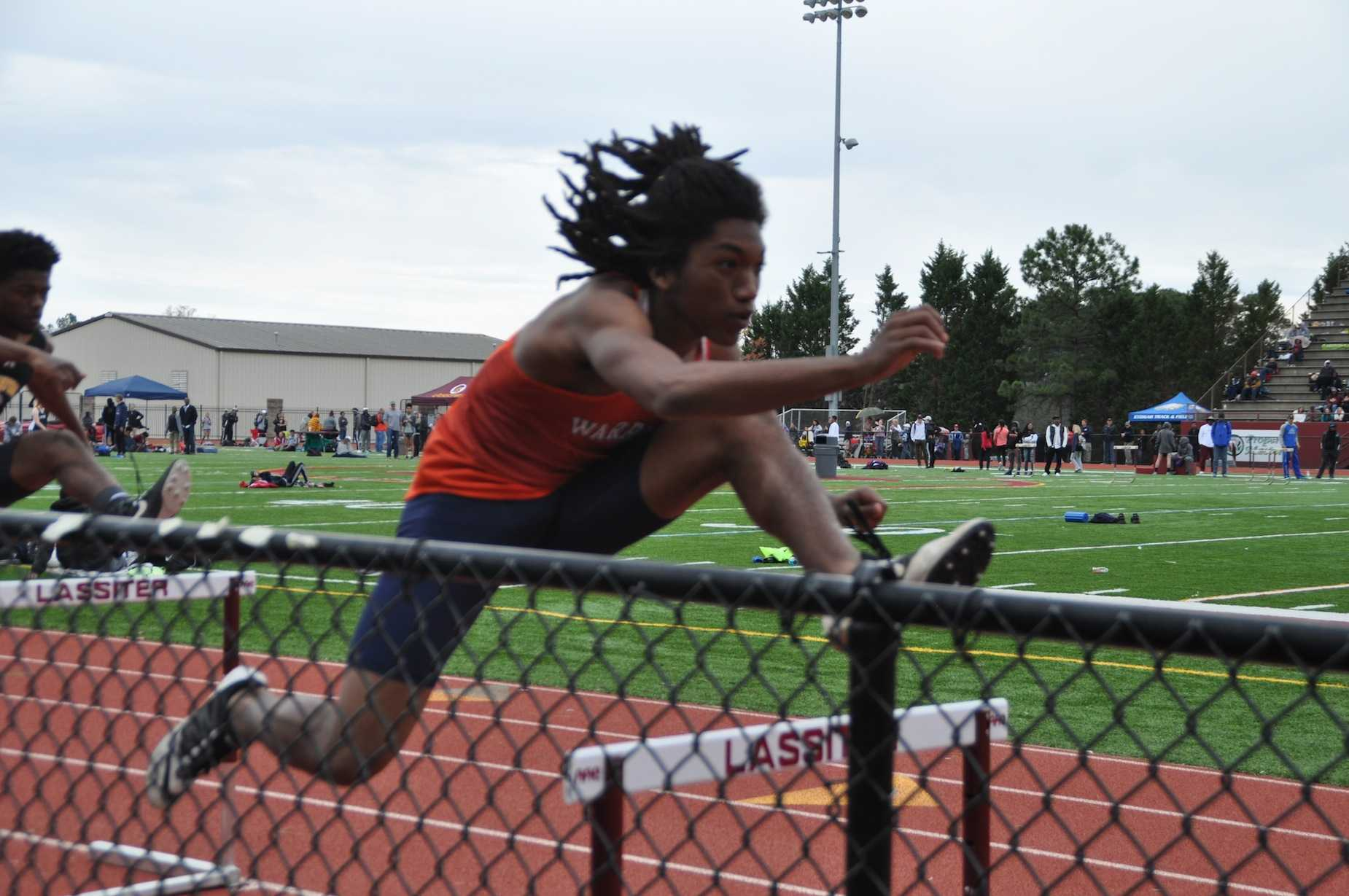 Senior Trenton Johnson looks onward with determination as he leaps over his final hurdle.