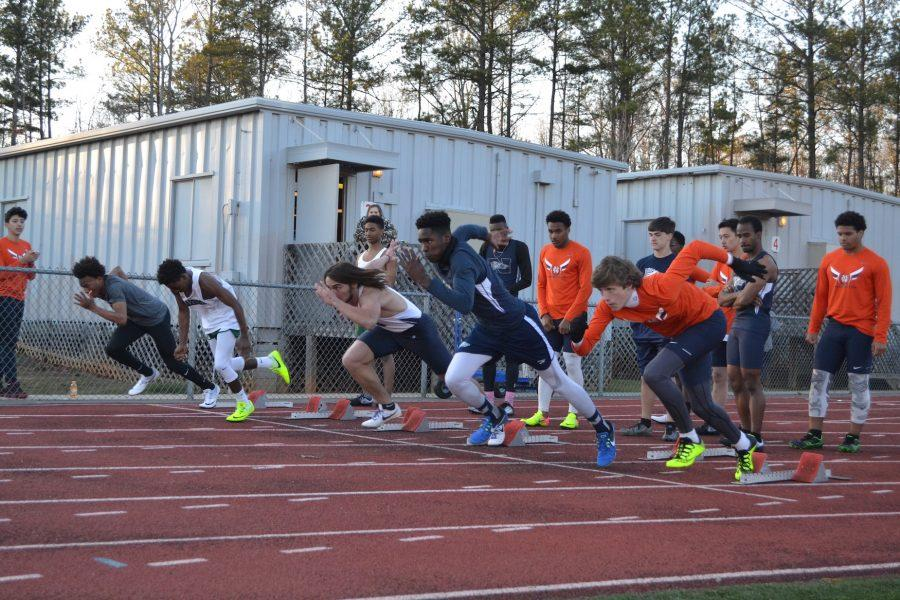 JV boys, including sophomore Michael Wise in Lane 6, take off in the 100MD, one of the shortest events of the meet.
