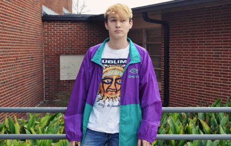 Junior Luke Pradella sports a vintage windbreaker and band tee, perfectly exemplifying the style of a teen from the 90s.