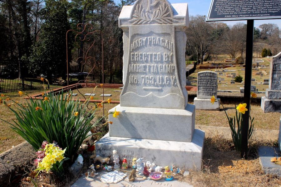 Phagan's grave, located in the Marietta Confederate Cemetery, stands tall with kids toys at the base brought by local citizens.