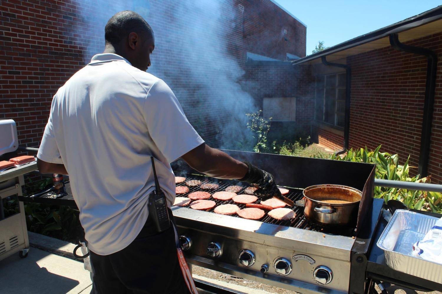 NC administrator, Kiel Southwell, grills hamburger beef and sausages in honor of Teacher Appreciation Week. Gathering together in the courtyard, NC teachers and administrators enjoyed their meal as they talked and celebrated with one another.