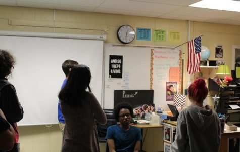 A lone student decides to sit down for the Pledge of Allegiance, expressing his freedom of speech.