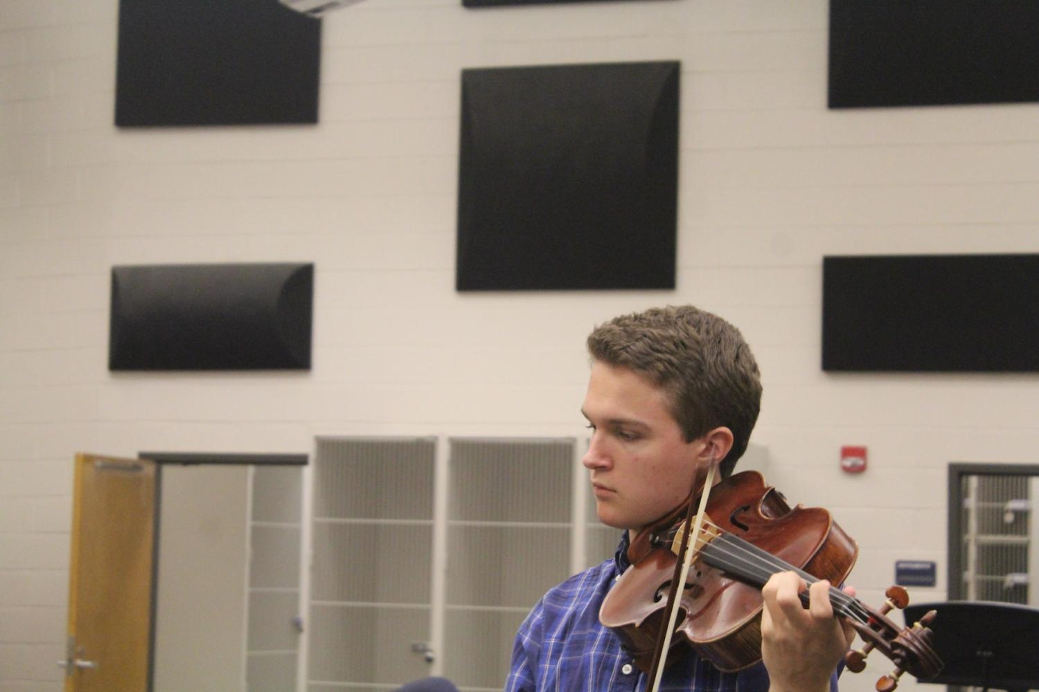 Jordan+Watt%2C+a+senior+at+NC%2C+continues+to+practice+for+his+upcoming+audition+for+the+Emory+Symphony+Orchestra.+Jordan+was+in+the+symphony+last+year%2C+an+outstanding+achievement+as+a+junior.+He+is+obviously+passionate+about+his+instrumental+progress+considering+this+will+be+his+second+time+going+to+this+audition.+%E2%80%9CIt+is+always+good+to+come+prepared%2C%E2%80%9D+Watt+says.+