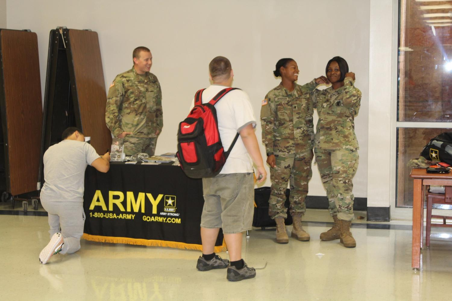 "Representatives from the U.S. Army Reserve stopped by during third period to ask students about the next stage in their lives and to consider the reserve. Sergeant Davina M. Jones said, ""Most people don't know that joining the reserves can help you pay for college. You get to go to the college of your choice nearly for free, all it requires is a few weeks of basic training."" Visit them in the cafeteria during lunch."