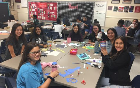 """Heart to Heart created and designed multiple jars for a coin drive to help the CASANA foundation. """"We were excited about the first creation of the jars because next week we hope to raise a lot of money for the organization with our customized jars that will hopefully urge people to donate,"""" sponsor Mrs. Theaker said."""