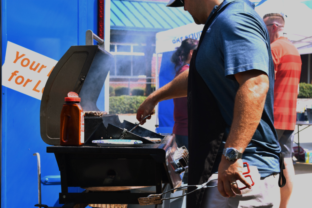 "Sponsored by Bay Equity Home Loans, NC held a free cookout to show their appreciation for the hard-working staff. The teachers could choose from hot dogs, hamburgers, and drinks in the courtyard. ""This is going to be dee-licious!"" Coach Bell said."