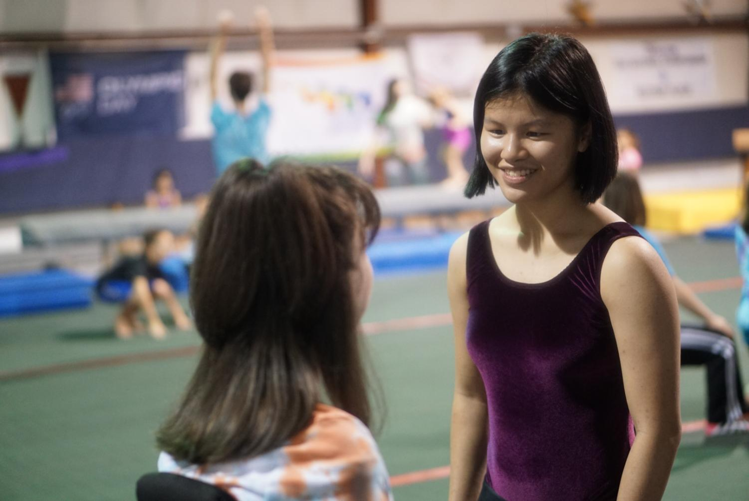 King smiles with one of her Special Olympians at the Chattooga School of Gymnastics and Dance. After a hard day's work at practice, King and her students are content with the work they have done. This bright smile is usually seen on King's face when working with the athletes in the gym.