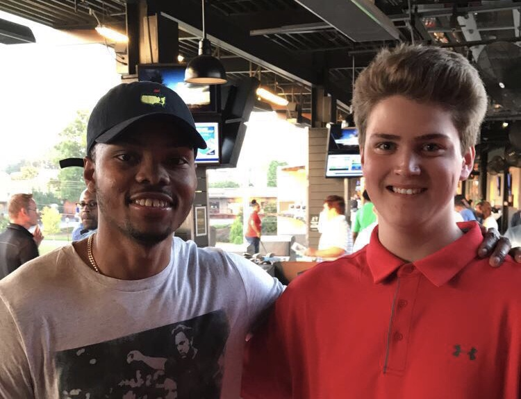 Chant reporter/photographer Sky Vinson pictured here with Atlanta Hawks guard Kent Bazemore at Bazemore's July TopGolf Tournament, put on by the Bazemore ARMS Foundation.