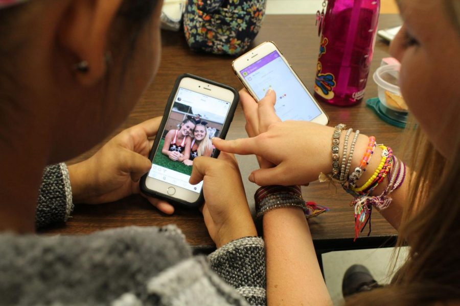 "Students avidly look through Instagram and Snapchat on a daily basis and slowly become consumed by it. Every day, students spend an abundant amount of time on their phones, affecting their friendships. ""If I spent less time on my phone, I would be able to focus more on the moment and not be busy trying to record it,"" junior Lauren Reagan said."