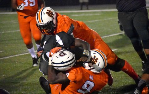 "Before the break, the Warriors took on the Pebblebrook Falcons in their fifth game of the season. NC defensive end Thurman Geathers (#9)  and offensive linebacker Trey Urquhart (#1) tackle Pebblebrook quarterback Jaquavious Jones (#1) before he can rush five yards. The team expected an easy win, as senior linebacker Christophe Cesar said, ""We've beat them every year I've been on the team, so I don't know why it would change now."""