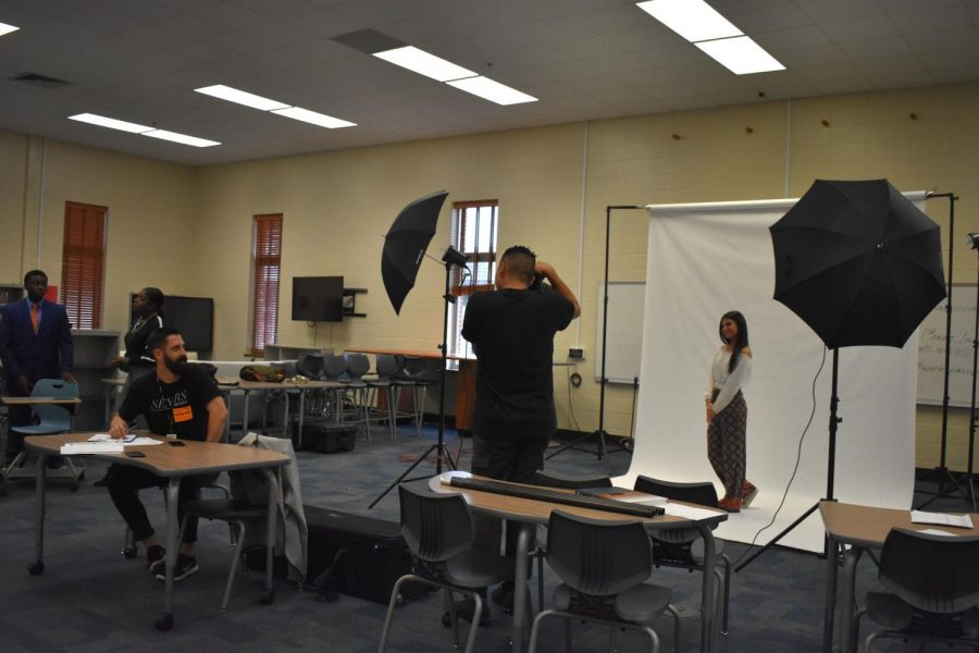 Today in the library, senior superlative pictures were taken for the nominees. Photographers from Cady Studios take senior Najda Sahovic's picture. NC yearbook staff will display the photos in the yearbook, distributed in April.