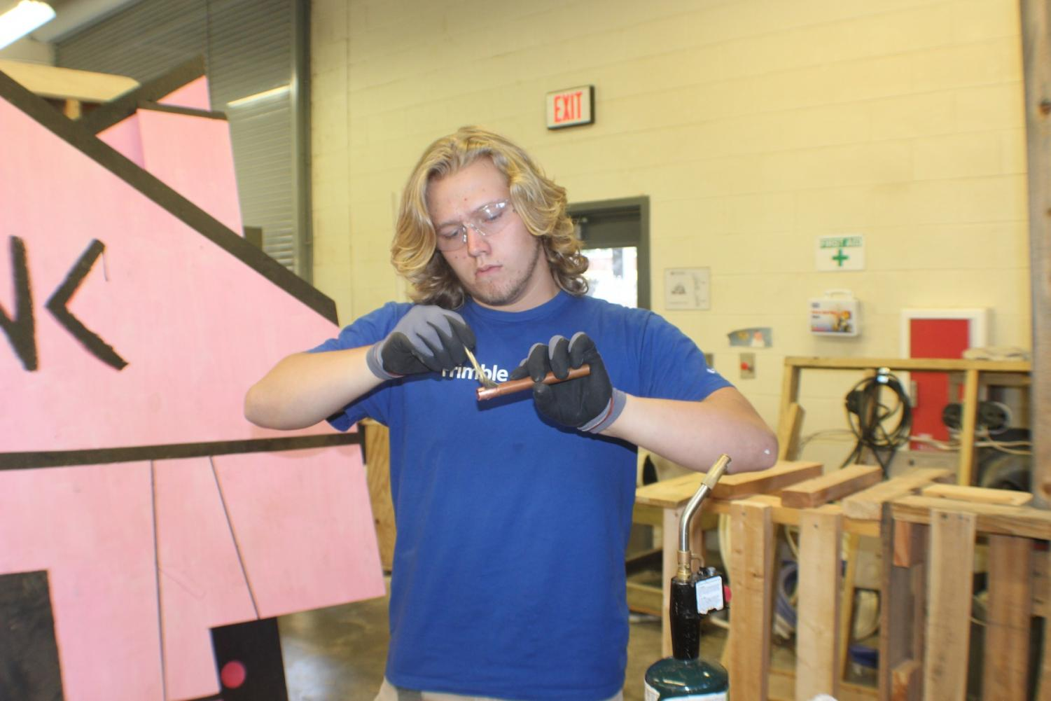 NC senior Nolan Moore worked hard enough to compete in the National Skills and Leadership Conference, earning a spot in the top ten. Moore works on sweating together two copper pipes, a necessary skill for his desired occupation. Sweating involves heating a solder into the pipes to merge them.