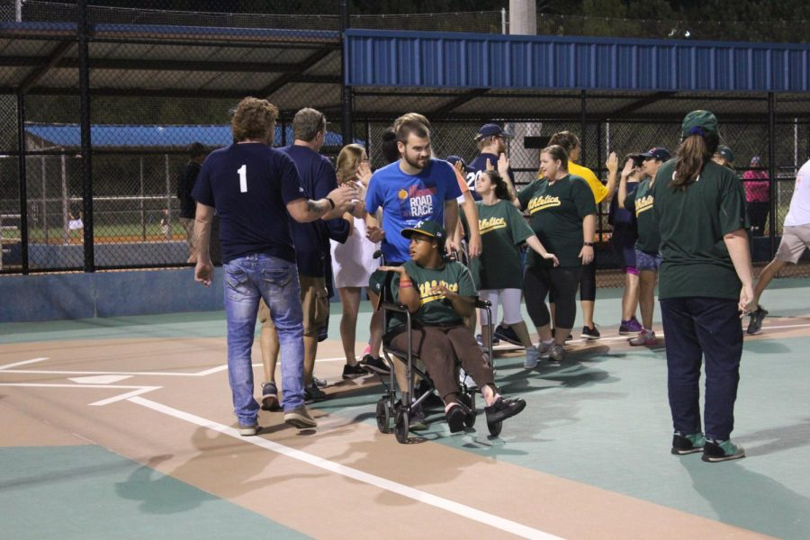 The Brewers and the A's team congratulated each other following the first game of the season. The non-competitive, all inclusive games allow the players to create lasting relationships with their teammates and shows them they are an important part of the community.