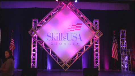 The stage of the SkillsUSA conference shows a huge SkillsUSA banner, where judges congratulated winners of the competition.