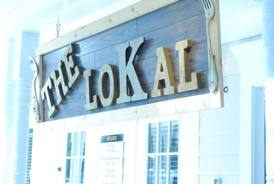 "The Lokal, the new and upcoming legacy of Legacy Park, opened to families in the Kennesaw-Acworth area this past September. ""The new setup is kid-friendly and the menu has a better selection. The decorations and lighting are ambient and nice to look at from the inside as well as the outside,"" sophomore Catherine Kulat said."
