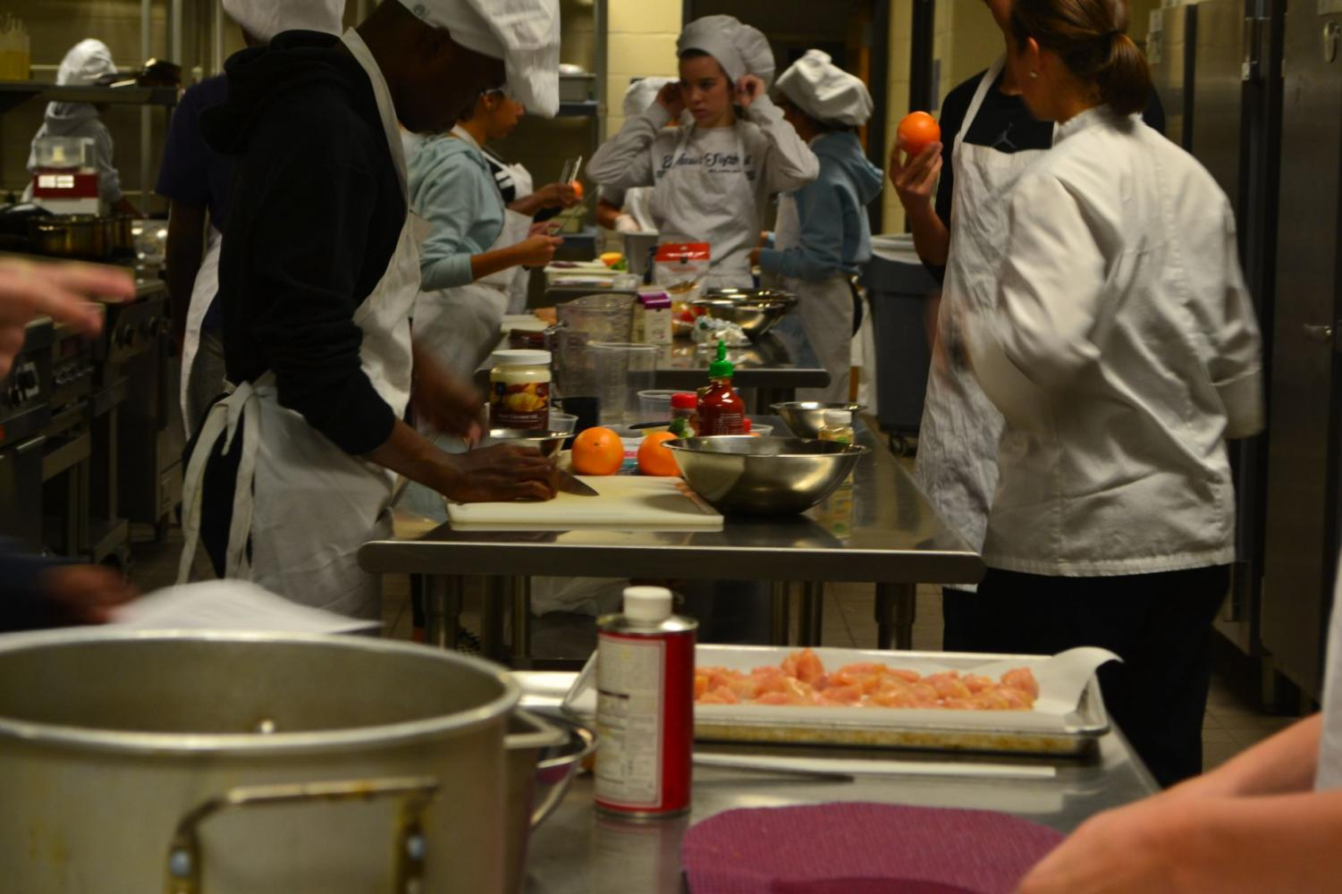 Incorporating orange, oats, sriracha, and chicken in their dishes, the students prepare the kitchen and find their recipes. This competition takes place every year and students love it. The competition encourages students to engage more in their work and focus more on the dishes.