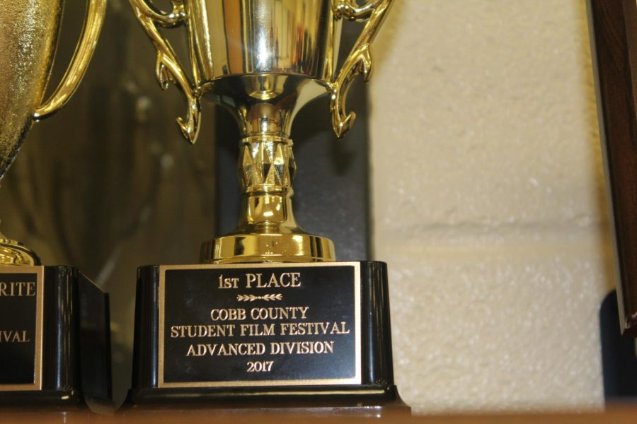 Syndicate Films, an audio/video tech team comprised of seniors Christophe Cesar, Hamza Nazer, TJ Bolden, Kele Maney, Kimani Guchu, Sydney Solomon, and Nathaniel Richards, took home the first place trophy at last night's Cobb County Film Fest. Their film's storyline includes a kidnapping, action, and drama. They earned NC their first win ever at the annual film festival.
