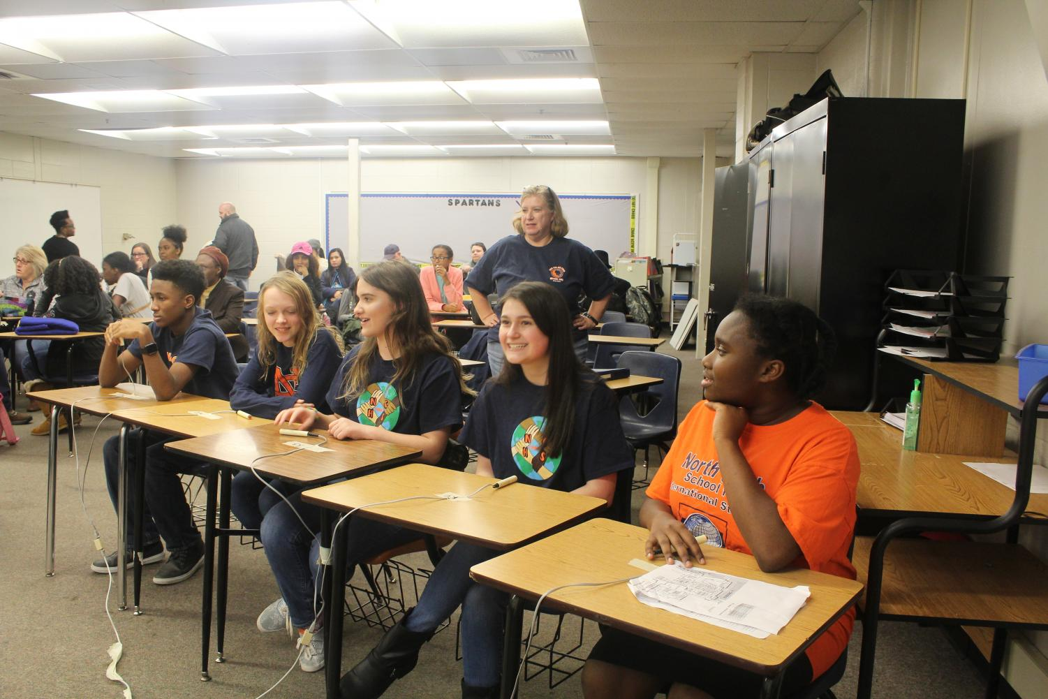 The team waits for their next round against McEachern to begin. Held in various classrooms around Campbell High School, the rounds feature ten questions regarding any of the books the students have read.