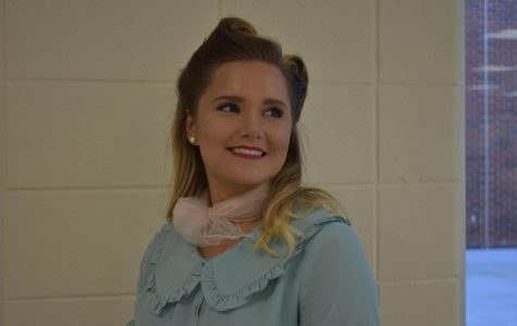 Twisting and hair spraying her updo to fit the 50s look, senior Chloe Petersen impressed her classmates with her fabulous look for NC's Hoopcoming dress-up week. From her shoes to the scarf on her neck, she masters the 50s style and prepares for later dates this week.