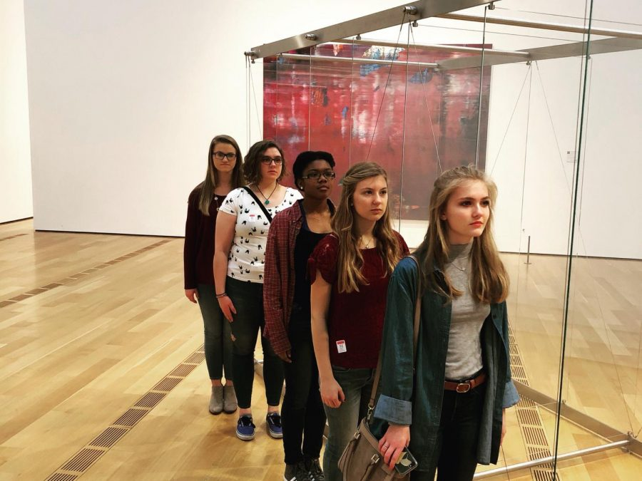 In a line with another permanent exhibits posed seniors Sarah Smith, Ruthie Southall, Mackenzie Sicard, Parris Waller, and Rebekah Cheshier.